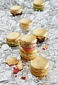 Golden macaroons on silver foil