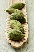 Cucumber melons in a wooden dish