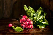 A bunch of radishes on a wooden surface