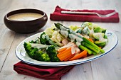 Steamed vegetables with cheese sauce