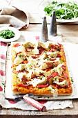 Salami pizza and artichokes with gremolata