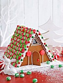 A colourfully decorated gingerbread house for Christmas