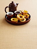 Portuguese custard tarts with cardamom coffee