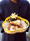 Ham and cheese toasties with chilli peppers and fries