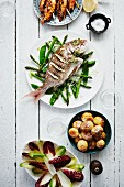 Grilled fish and prawns with potatoes and salad
