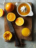 Freshly pressed orange juice and oranges