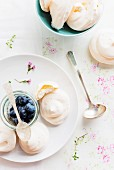Delicate rosewater pavlovas with fresh blueberries