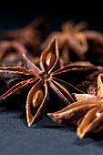 Star anise against a black background