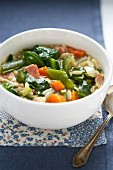 Vegetable soup with orzo pasta and bacon