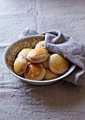 Rustic homemade scones in a bowl with a cloth