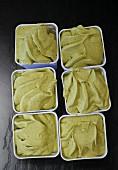 Six tubs on pistachio ice cream