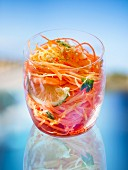 Carrot salad with prawns and limes