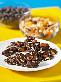 Chocolate crispy cakes with nuts and dried fruit