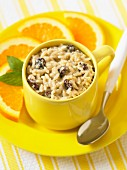 Rice pudding with raisins and orange slices