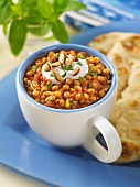 Spiced lentils with yoghurt, almonds and unleavened bread