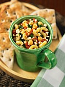 Elbow macaroni with spinach, feta and chickpeas served with focaccia