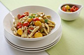 Pasta with colourful tomatoes, oregano and pine nuts