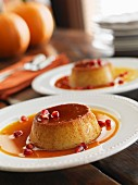 Pumpkin creme caramel with pomegranate seeds