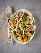 Penne pasta with clams and vegetables