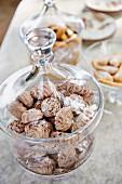 Chocolate meringues in a storage jar