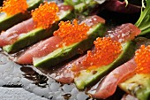 Avocado slices with fish and fish roe