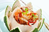 Seafood salad in a grapefruit bowl (Thailand)