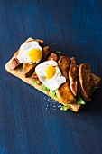 Bruschetta topped with goose liver and fried eggs