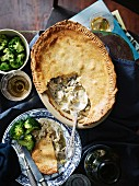 Chicken, leek and mushroom pie served with broccoli and wine