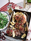 Roast lamb with pomegranate seeds and vegetables