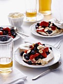 Pavlovas with berries and flaked almonds