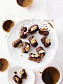 Chocolate and walnut confectionery served with coffee