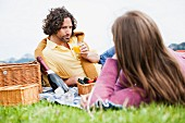 A middle aged couple having a picnic, Wallberg, Tegernsee, Bavaria, Germany