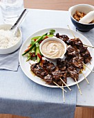 Beef skewers with satay sauce and rice