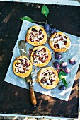 Plum cakes with hazelnut crumbles