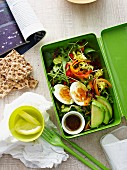 A lunch box with egg salad