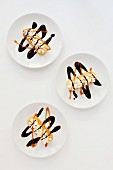 Twinkie bars with cream, chocolate sauce and caramel sauce (USA)