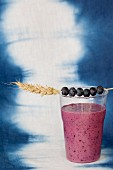 A blueberry smoothie with apple and banana