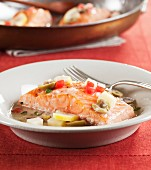 Marinated salmon with green olives, peppers and lemon