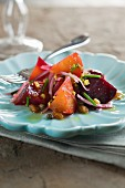 Beetroot and golden beet salad with raisins, red onions and pistachios
