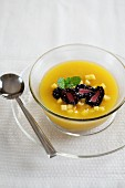 Cold mango soup with blackberries and mint