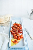 Roasted cherry tomatoes and unleavened bread