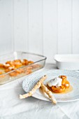 Oven-baked apricot with flaked almonds and honey serve with Greek yoghurt and sesame seed pastries