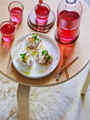 Blinis with smoked herring and redcurrant vodka