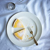 Two slices of lemon tart with icing sugar (seen from above)