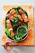 Salmon skewers with coriander pesto