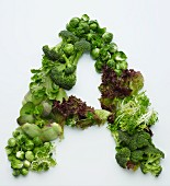 The letter A made from green vegetables and lettuce