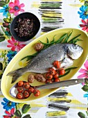 Baked sea bream with tomatoes, green beans and tapenade
