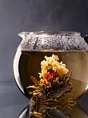 A pot of tea and a tea flower