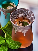 Peppermint tea with pine nuts