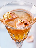 A cocktail made with black tea, champagne and vanilla